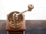 Close up of coffee-mill with coffee bean inside for crushing - 184152288
