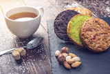 Homemade Christmas or New Year holiday oatmeal cookies with pistachios and chocolate. Concept of festive desserts - 184157265