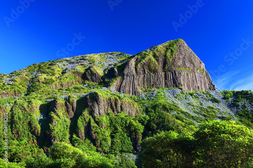Foto op Canvas Donkerblauw Rocha dos Bordoes - Bordoes Rock - Famous landmark of Flores Island, Azores, Portugla, Europe