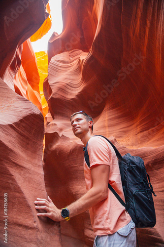 Foto op Plexiglas Bruin Young man exploring antelope Canyon in the Navajo Reservation near Page, Arizona USA