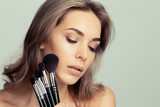 Beauty girl with makeup brushes - 184161067
