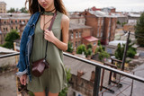 Woman outfit fashion look concept. Travel photographer lifestyle. Activity leisure.