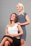 Two women wearing fashionable dresses. - 184170838