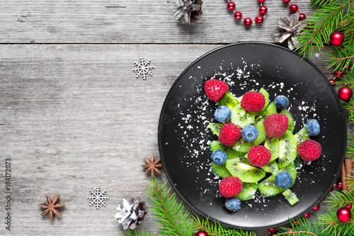 kiwi christmas tree with berries and coconut looks like snow