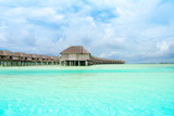 Wooden villas over water of the Indian Ocean, Maldives - 184179625