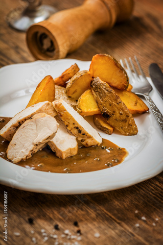 Chicken with pepper sauce - 184186687