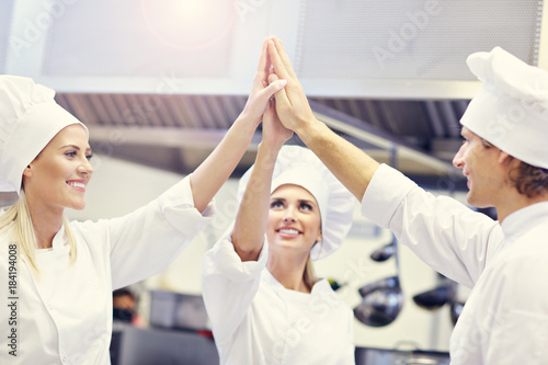 Sticker Busy chefs at work in the restaurant kitchen