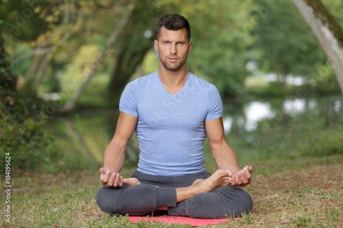 Plakat young handsome man meditating
