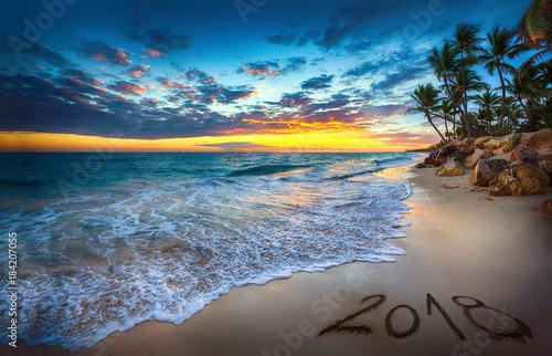 Foto auf Acrylglas See sonnenuntergang Happy New Year 2018 concept, lettering on the beach. Sea sunrise