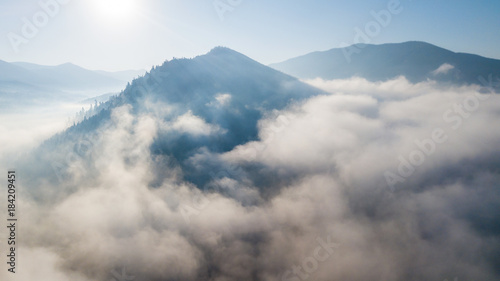 Aerial view of the mountains with a morning fog - 184209451