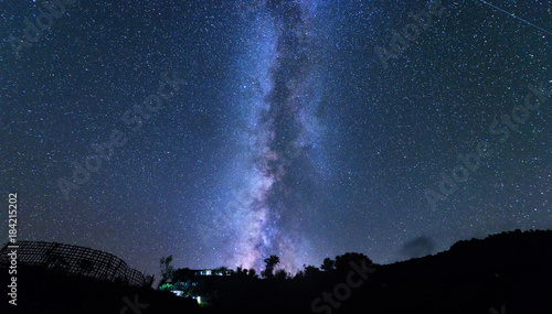 Milky Way and tree. Amazing rural scene with starry sky at night in Nepal. Space background with blue sky with stars. Beautiful night landscape with bright milky way. Amazing universe. Nature