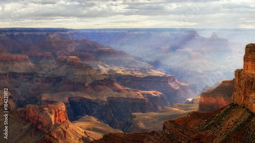 Foto op Aluminium Chocoladebruin Sunrise spilling into the Grand Canyon at Mahave Point
