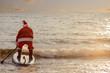 Santa on SUP board