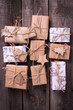 Gift boxes with presents on aged  wooden background. - 184229847