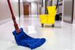 Mopping wet floor in hallway