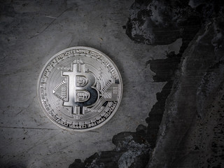 Silver bitcoin BTC coin on metal background, macro closeup.