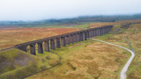 Aerial View of Train passing over the Ribblehead Viaduct Settle-Carlisle Railway, North Yorkshire