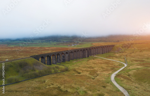 Foto op Canvas Wit Aerial View of Train passing over the Ribblehead Viaduct Settle-Carlisle Railway, North Yorkshire