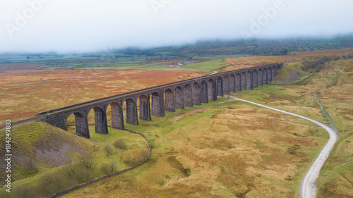 Fototapeta Aerial View of Train passing over the Ribblehead Viaduct Settle-Carlisle Railway, North Yorkshire