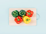 Fresh bell peppers on a chopping board - 184251481