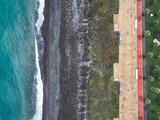 Aerial view of sea, pebble beach and embankment with no people. Top view. - 184256815