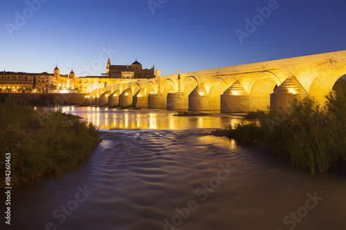 Sticker Ancient Roman Bridge of Cordoba, Spain, at night