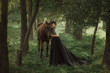 Gourmet lady in a vintage dress. A beautiful rider gently hugs the horse. Artistic Photography