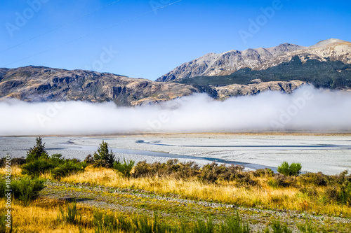 Plexiglas Bergrivier Yellow forest and river in New Zealand mountains
