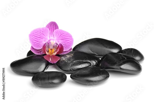 In de dag Spa spa symbol with orchid and black stones isolated on white background