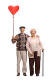 Elderly couple with a heart shaped balloon - 184273084