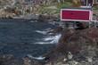 red fishing stage building along rocky coastline of Fogo Island, Newfoundland