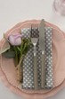 Beautiful table setting with floral arrangement