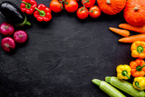 Colorful vegetables for healthy diet. Paprika, tomatoes, carrot, zucchini, eggplant on balck background top view copyspace - 184300469