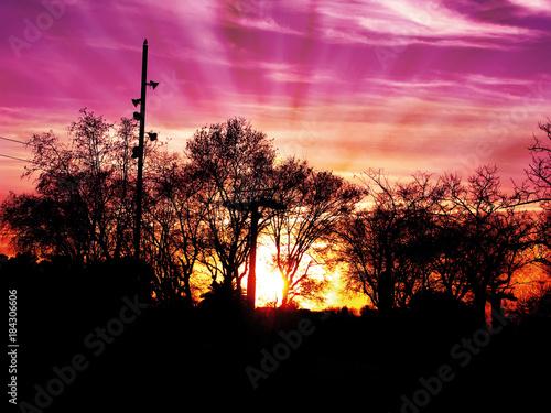 Foto op Canvas Baksteen Sun rays between clouds,at dusk