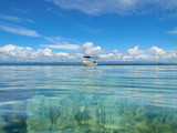 Seascape seen from calm water surface a boat with cloudy blue sky, Bocas del Toro, Caribbean sea, Panama, Central America - 184315248