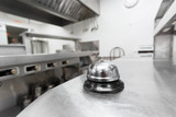 Alert bell on kitchen table in a restaurant - 184316655
