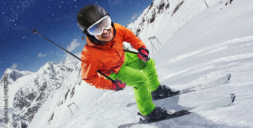 Winter Sport. Skier in mountains. - 184321413