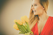 Pretty woman with yellow tulips bunch - 184326045