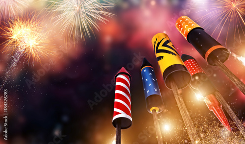 Bottom view of fireworks rockets launching into the sky