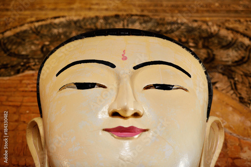 Plexiglas Boeddha Face of sitting Buddha statue inside one of hundred old temples in Bagan, Myanmar