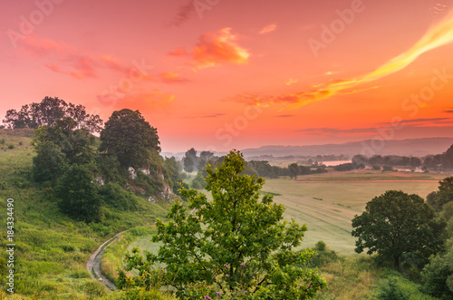 Fotobehang Koraal Colorful morning landscape in the morning, Poland, Tyniec near Krakow