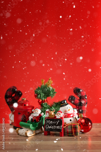 Aluminium Rood Christmas holiday background with Santa and decorations. Christmas landscape with gifts and snow. Merry christmas and happy new year greeting card with copy-space.