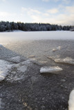 Wintry landscape scenery from Finland. Image taken from low point of view. Sunrise. Snow covered lake ice. - 184336238