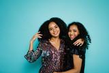 Two women happy standing together in studio - 184347018