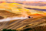 Combine operating in the Palouse in eastern Washington state a vast area of mostly wheat farming - 184351895