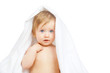 Caucasian baby covered with towel isolated on white background
