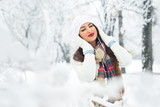 Attractive young woman in wintertime outdoor - 184385412