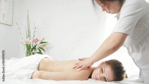 Sticker Tibetian massage in spa salon for young woman