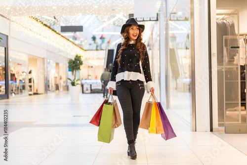 Caucasian women walking in shopping mall