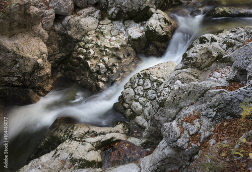 Waterfall among the beautiful texture stones in Slovenia - 184416077